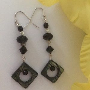 Swarovski crystals earrings .